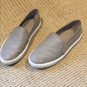 Gray leather slip ons